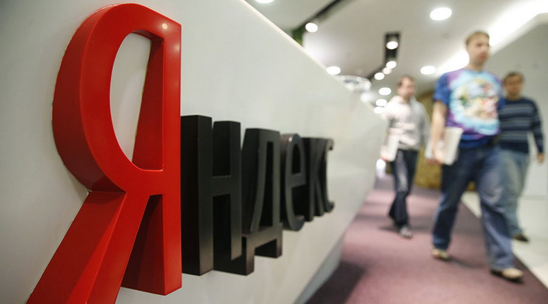 People pass by sign of Yandex company, a Russian internet search engine, at its headquarters in Moscow