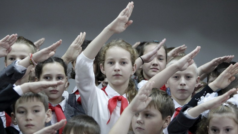 Children attend a ceremony for the inauguration of new members of the Pioneer Organization in Stavropol region