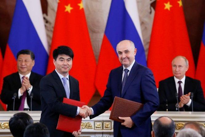 Отвергнутый правительством США китайский телекоммуникационный гигант Huawei приветствуют в России
